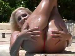 Blonde bikini babe gets her pussy tanned