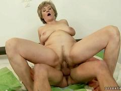 Busty mature lady fucking hard with a young man