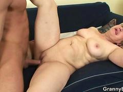 Granny gets nailed by a muscular tanned stud