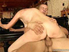 Sexy mature woman riding big young cock
