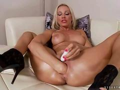 Sandy masturbating and fisting her pussy