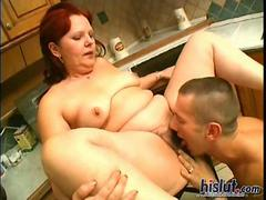 Chubby redhead granny gets fucked in the kitchen