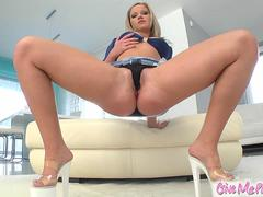 Sweet and sexy Sunny has a set of perky tits and a great round ass. She spreads her pussy and stuffs