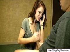 Brunette teen tugs while on the phone