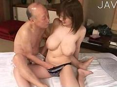 busty babe is wanking him between her tits