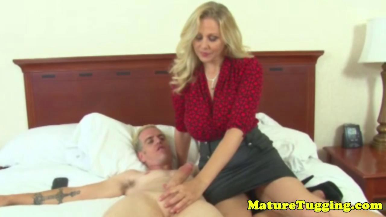 image Bigtitted milf jerks off a young dude