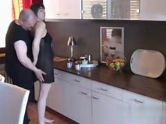 Horny husband fucks his mature wife in the kitchen