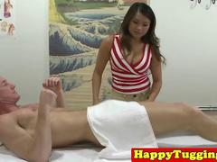 Busty asian masseuse grinding and tugging