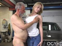 Skinny blonde gets fucked in garage by geezer