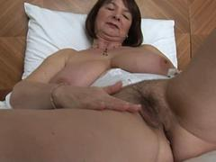 Slutty granny with big natural boobies loves to show off