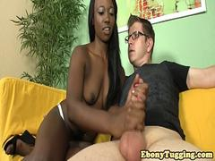 Gorgeous black babe tugging white cock