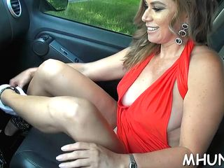 this steamy milf in stunning red dress is teasing and showing her shaved muff in the car