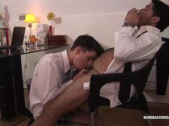 A twink fucking his boss hunk in the office in his tight anal hole