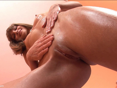 Brunette Oils Up and Massages her Body