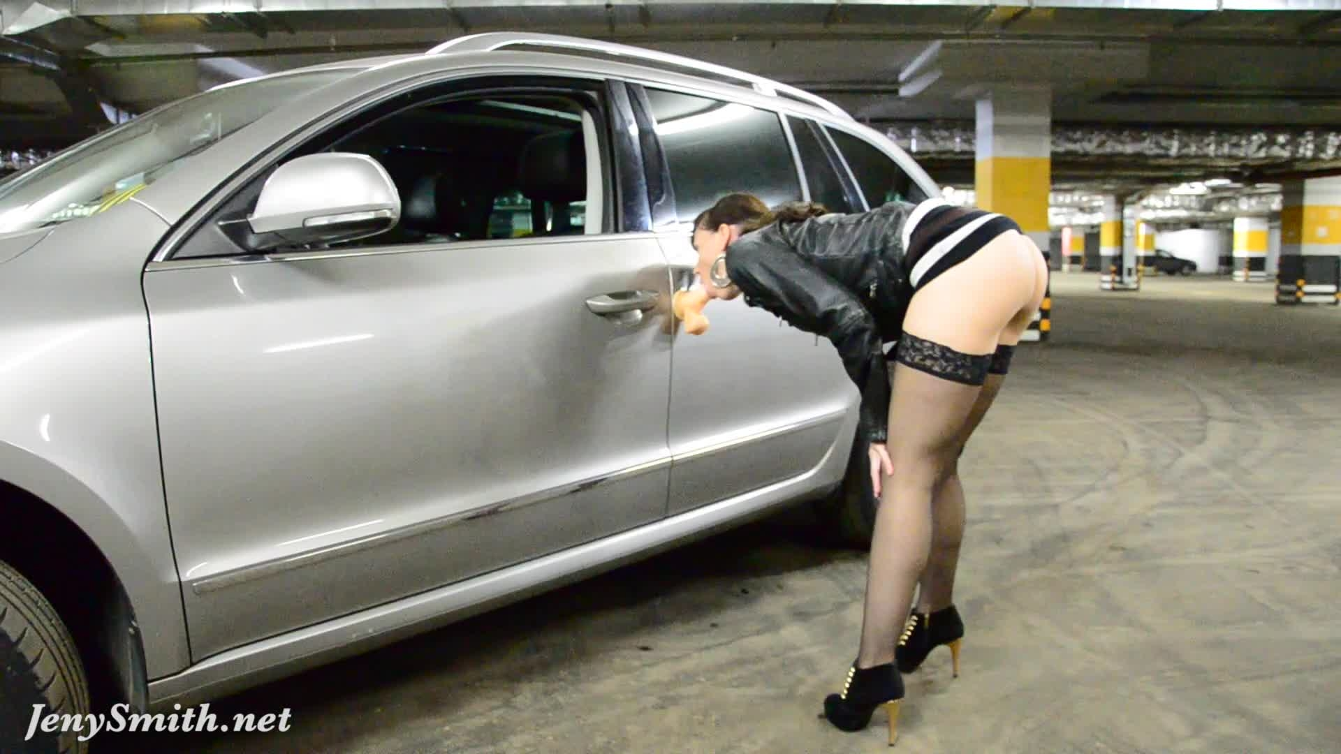 image Jeny smith oiling her naked body in a public parking