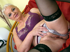 Busty granny undressing and playing with her tits and pussy