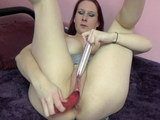 Mature redhead Lia Shayde is playing with a pair of dildos