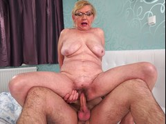 Horny hot granny is ready to swallow that fat member and then to get it on in multiple poses with this horny lad