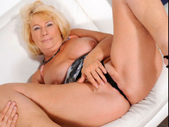 Older blonde lady in sexy lingerie is playing with her toys on a webcam